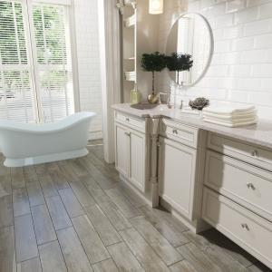 berg dark grey wood effect tile on the floor of a bathroom